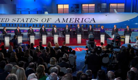 Republican presidential candidate, businessman Donald Trump, center, speaks as the other candidates look on during the CNN Republican presidential debate at the Ronald Reagan Presidential Library and Museum on Wednesday, Sept. 16, 2015, in Simi Valley, Calif. (AP Photo/Mark J. Terrill)